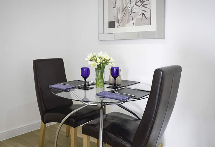 one bed serviced apartment dining area